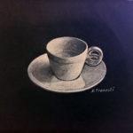 Tazzina per caffe su sfondo nero - Carboncini colorati