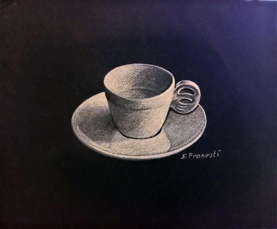 Tazzina per caffe su sfondo nero Carboncini colorati